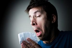 Насморк - один из признаков аллергии