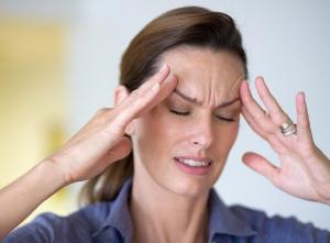 Головная боль - один из симптомов гипертонии