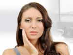 Зуб мудрости режется и болит: что делать в такой ситуации